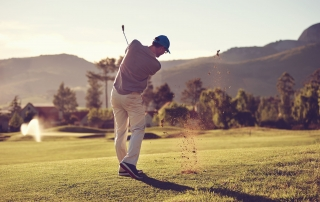 24915040 - golfer hitting golf shot with club on course while on summer vacation