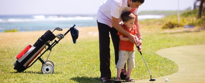 7538781 - father teaching his son to play golf